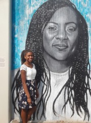 Alicia Garza (& my daughter on the left, Angela Carter) - Painted by Julia Bottoms